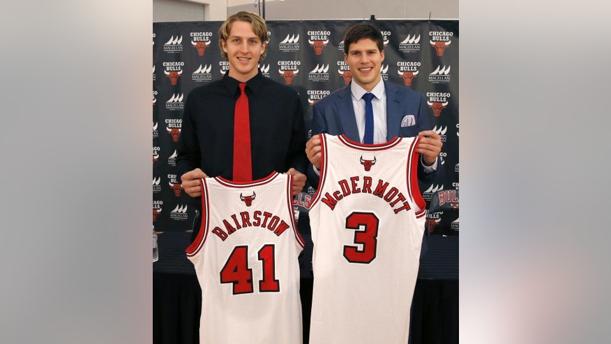 The Chicago Bulls' first and second round draft picks Cameron Bairstow (41) from Brisbane, Australia, and Creighton University star Doug McDermott,  pose with their Bulls jerseys during a news conference Monday, June 30, 2014, in Deerfield, Ill. (AP Photo/Charles Rex Arbogast)
