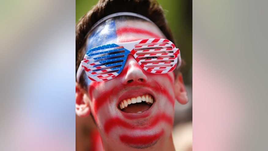 United States fan Joe Trombley, of Farmington, Mich., reacts while watching the 2014 World Cup soccer match between the United States and Belgium at a public viewing party, in Detroit, Tuesday, July 1, 2014. (AP Photo/Paul Sancya)