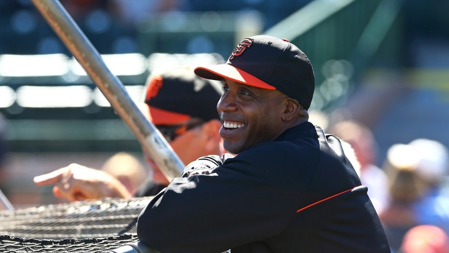 Mar 10, 2014: San Francisco Giants former outfielder Barry Bonds laughs during batting practice prior to the game against the Chicago Cubs at Scottsdale Stadium.