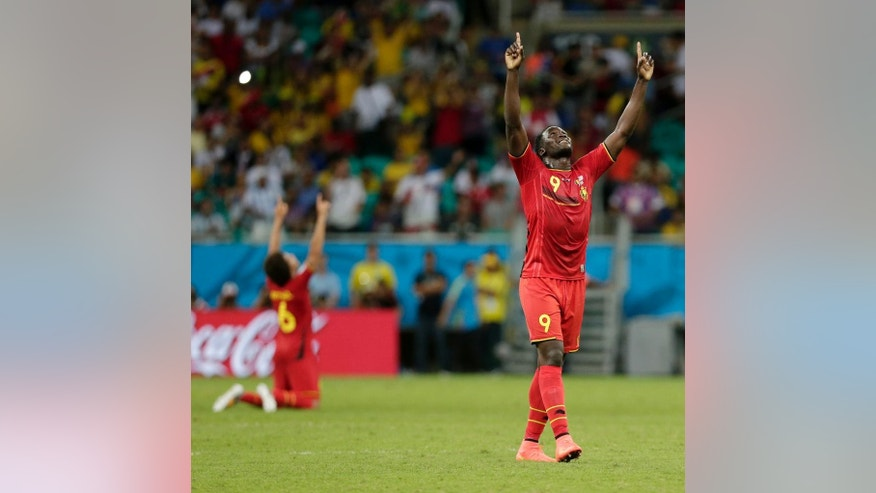 Belgium's Romelu Lukaku celebrates after Belgium defeated the USA 2-1 in extra time to advance to the quarterfinals during the World Cup round of 16 soccer match between Belgium and the USA at the Arena Fonte Nova in Salvador, Brazil, Tuesday, July 1, 2014. Lukaku scored his side's second and winning goal. (AP Photo/Marcio Jose Sanchez)