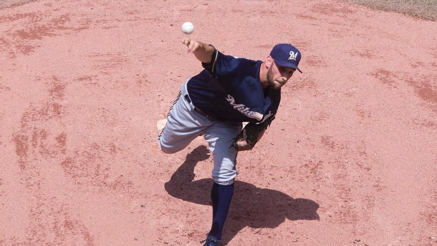 Milwaukee Brewers starting pitcher Marco Estrada works against the Toronto Blue Jays  during the first inning of a baseball game, Tuesday, July 1, 2014 in Toronto. (AP Photo/The Canadian Press, Chris Young)