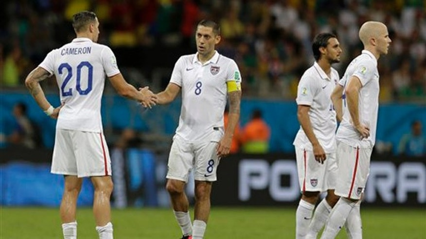 United States' Clint Dempsey (8) shakes hands with Geoff Cameron (20) during the World Cup round of 16 soccer match between Belgium and the USA at the Arena Fonte Nova in Salvador, Brazil, Tuesday, July 1, 2014. Belgium defeated the USA 2-1 to advance to the quarterfinals. (AP Photo/Natacha Pisarenko)