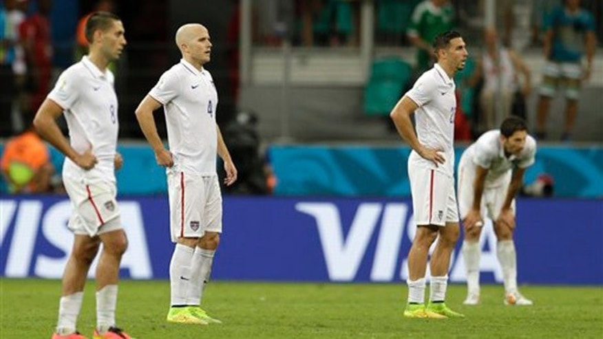 USA players wait for play to resume after Belgium's Romelu Lukaku scored his side's second goal in extra time during the World Cup round of 16 soccer match between Belgium and the USA at the Arena Fonte Nova in Salvador, Brazil, Tuesday, July 1, 2014. (AP Photo/Natacha Pisarenko)