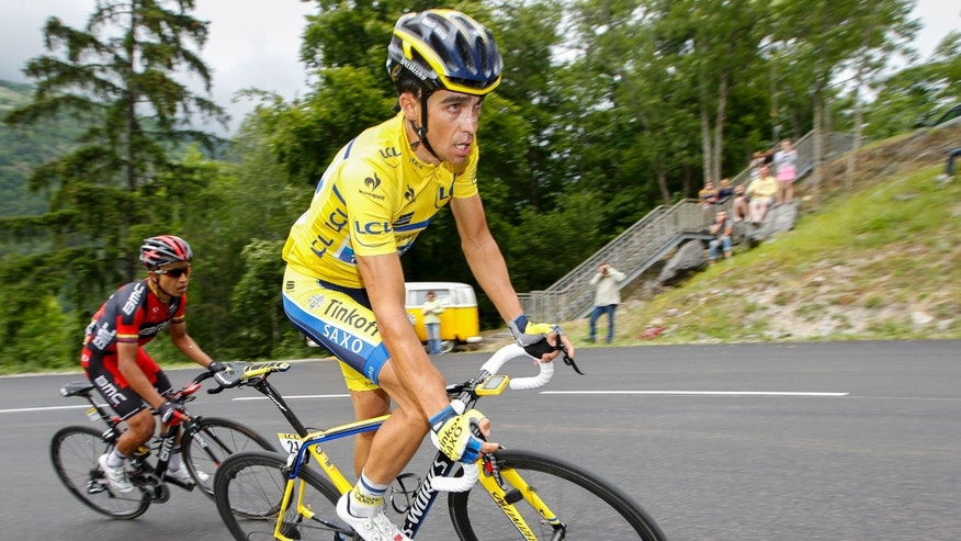 COURCHEVEL, FRANCE - JUNE 15: Alberto Contador of Spain and Team Tinkoff-Saxo, wearing the yellow leaders jersey, in action during the eighth stage of the Criterium du Dauphine on June 15, 2014 between Megeve and Courchevel, France.  (Photo by Kristof Van Accom/Getty Images)