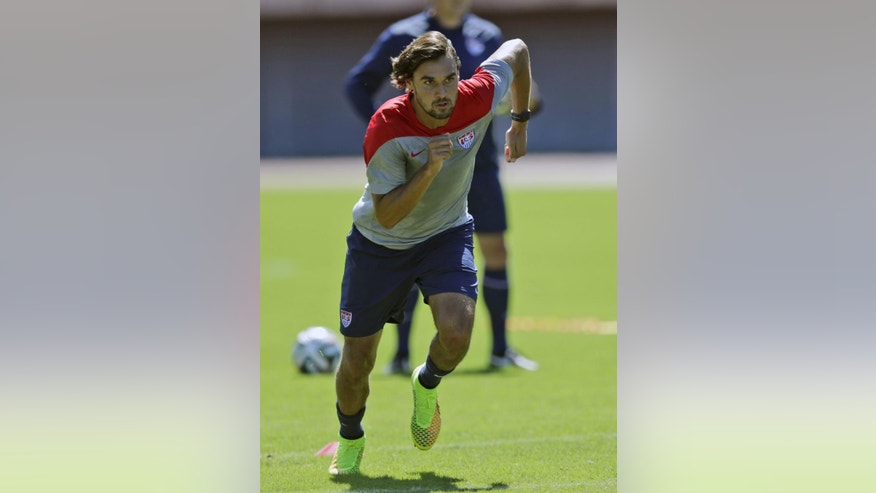 FILE - In this Monday, June 30, 2014, file photo, United States' Chris Wondolowski works out during a training session in Salvador, Brazil. Wondolowski, a member of the Kiowa Tribe, is playing in the World Cup. His presence on the U.S. soccer team is a source of pride for the tribe of 12,000 with headquarters in Oklahoma. (AP Photo/Julio Cortez, File)