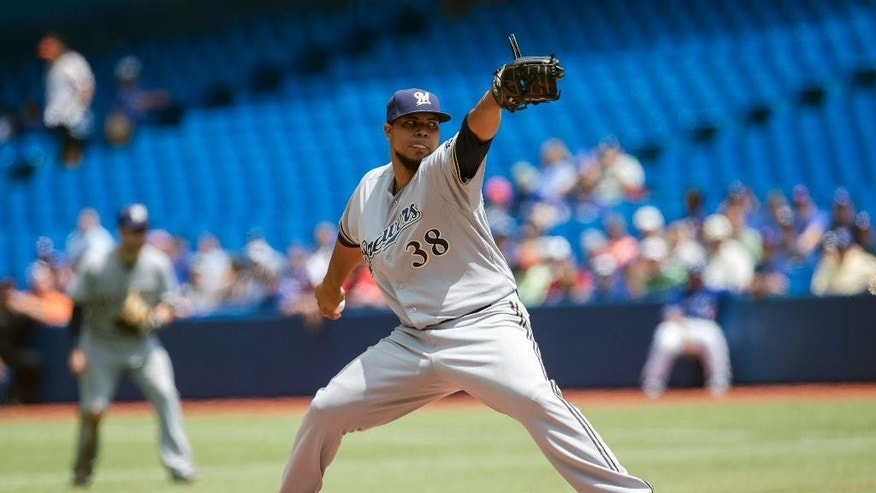 Milwaukee Brewers starting pitcher Wily Peralta works against the Toronto Blue Jays during first inning interleague baseball action in Toronto on Wednesday July 2 , 2014. (AP Photo/The Canadian Press, Chris Young)