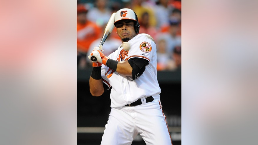 Baltimore Orioles' Nelson Cruz reels back from a pitch against the Texas Rangers during the third inning of a baseball game, Tuesday, July 1, 2014, in Baltimore. (AP Photo/Nick Wass)