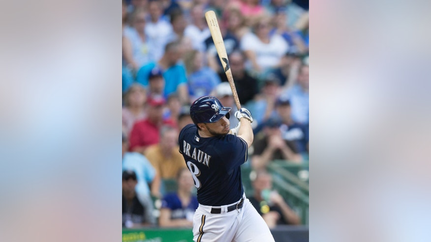 Ryan Braun of the Milwaukee Brewers' hits a two RBI triple off of Charlie Blackmon of the Colorado Rockies' during the fifth inning of a baseball game Saturday, June 28, 2014, in Milwaukee. (AP Photo/Tom Lynn)