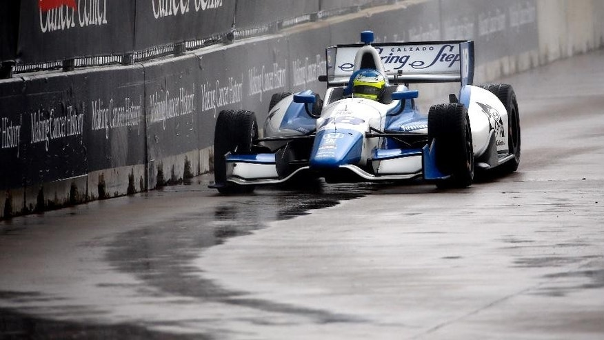 Carlos Huetas (18), of Colombia, drives into Turn 3 during the first of two IndyCar Grand Prix of Houston auto races Saturday, June 28, 2014, in Houston. Huetas won the race. (AP Photo/David J. Phillip)