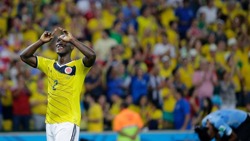 Colombia's Cristian Zapata celebrates after the World Cup round of 16 soccer match between Colombia and Uruguay at the Maracana Stadium in Rio de Janeiro, Brazil, Saturday, June 28, 2014.  Colombia won the match 2-0. (AP Photo/Sergei Grits)