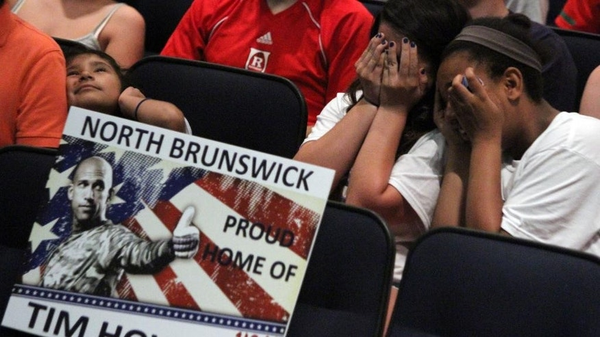 North Brunswick High School hosted a World Cup soccer match viewing party for the United States against Belgium to watch goalie Tim Howard who attended North Brunswick High School in North Brunswick, N.J., Tuesday, July 1, 2014. (AP Photo/The Asbury Park Press, Mark R. Sullivan)