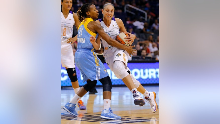 Phoenix Mercury guard Diana Taursai, right, is fouled by Chicago Sky guard Jamierra Faulkner (21) during the first half of a WNBA basketball game on Wednesday, July 2, 2014, in Phoenix. (AP Photo/Matt York)