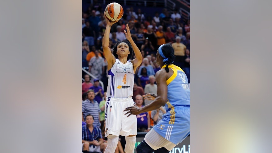Phoenix Mercury forward Candice Dupree (4) shoots over Chicago Sky center Sylvia Fowles during the first half of a WNBA basketball game, Wednesday, July 2, 2014, in Phoenix. Dupree became the 22nd player in league history to reach 4,000 points during the game. (AP Photo/Matt York)