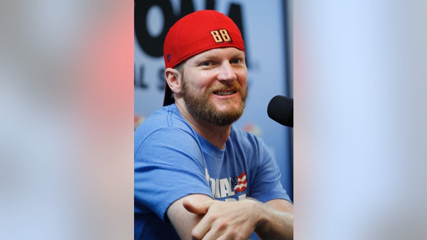 Driver Dale Earnhardt Jr. answers questions at a news conference before a NASCAR Sprint Cup practice session at Daytona International Speedway in Daytona Beach, Fla., Thursday, July 3, 2014. (AP Photo/Terry Renna)