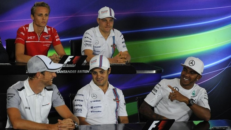Front row, left to right, Britain's Jenson Button of McLaren Mercedes, Brazil's Felipe Massa of Williams, Britain's Lewis Hamilton of Mercedes, back row, left to right, Britain's Max Chilton of Marussia and Finland's Valterri Bottas of Williams are seen during a press conference ahead of this weekend's Formula 1 British Grand Prix at Silverstone, England, on Thursday, July 3, 2014. (AP Photo/Rui Vieira)