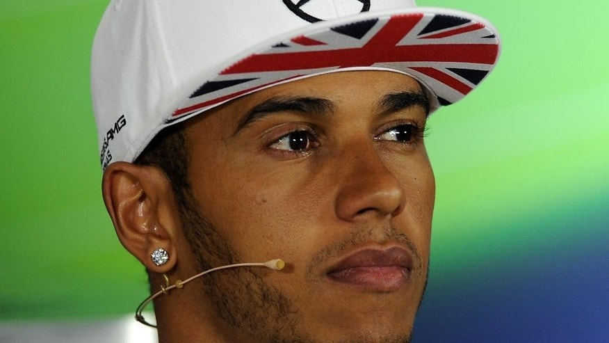 British Lewis Hamilton of Mercedes, pauses,  during a press conference ahead of this weekend's Formula 1 British Grand Prix at Silverstone, England, Thursday, July 3, 2014. (AP Photo/Rui Vieira)