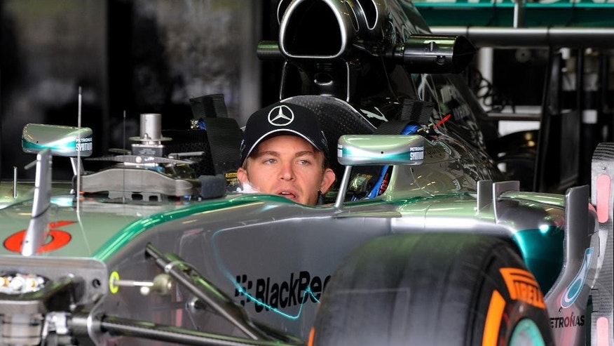 Germany's Nico Rosberg of Mercedes sits in his car in the pits garage, ahead of this weekend's Formula 1  British Grand Prix at Silverstone, England, on Thursday, July 3, 2014. (AP Photo/Rui Vieira)