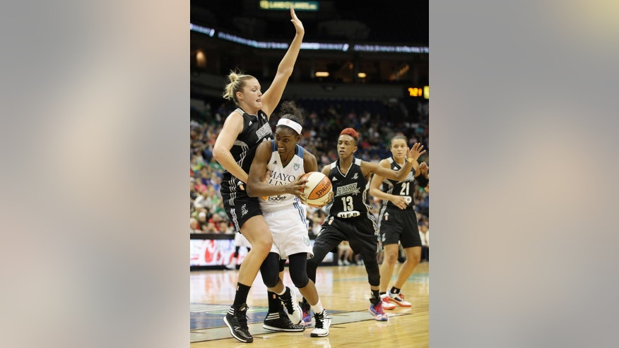 Minnesota Lynx forward Asia Taylor, second from left, pushes the ball around San Antonio Stars center Jayne Appel in the first half of a WNBA basketball game, Thursday, July 3, 2014, in Minneapolis.  (AP Photo/Stacy Bengs)