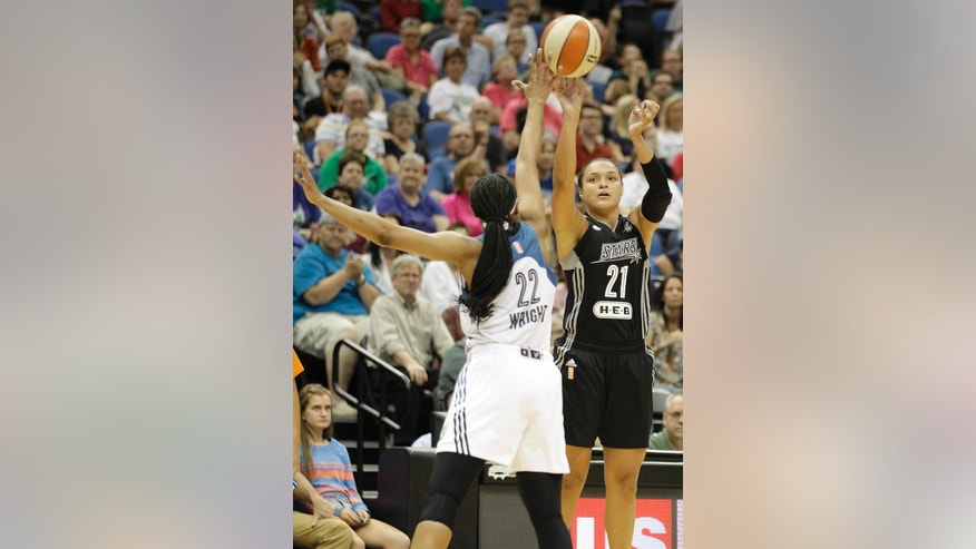 San Antonio Stars guard Kayla McBride (21) shoots against Minnesota Lynx guard Monica Wright (22) in the second half of a WNBA basketball game on Thursday, July 3, 2014, in Minneapolis. The Lynx won 91-84. (AP Photo/Stacy Bengs)