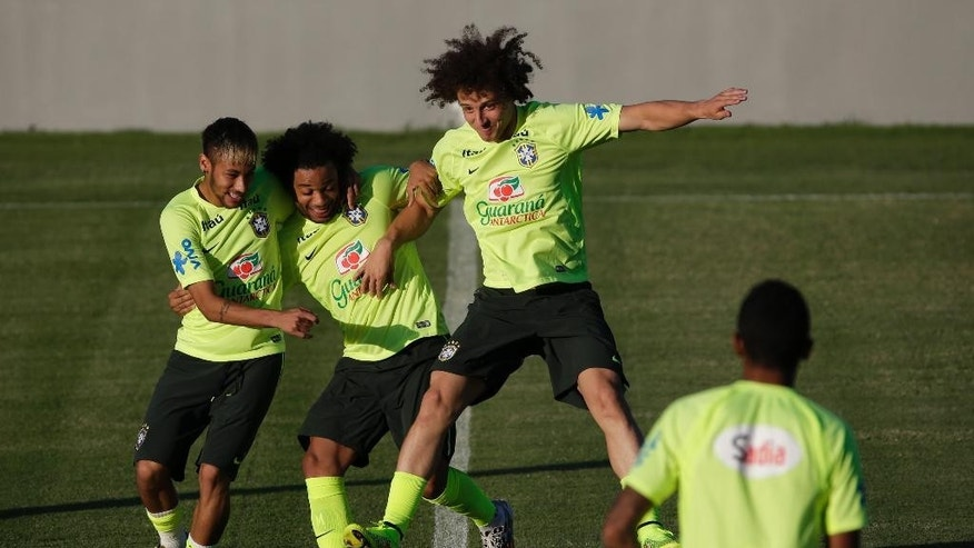 Brazil's Neymar, left, Marcelo, center, and David Luiz joke during a training session in Fortaleza, Brazil, Thursday, July 3, 2014. Brazil will face Colombia on Friday in a quarterfinal soccer match at the World Cup. (AP Photo/Felipe Dana)