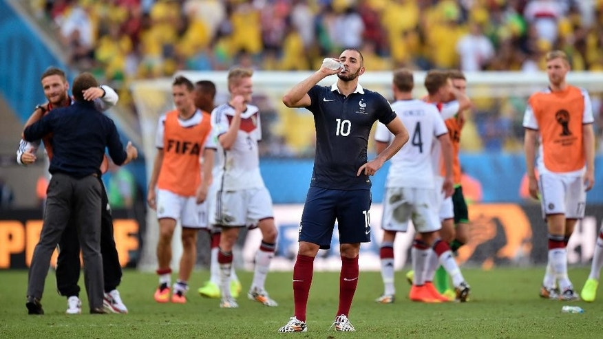 France's Karim Benzema takes a drink at the end of the World Cup quarterfinal soccer match between Germany and France at the Maracana Stadium in Rio de Janeiro, Brazil, Friday, July 4, 2014. (AP Photo/Martin Meissner)
