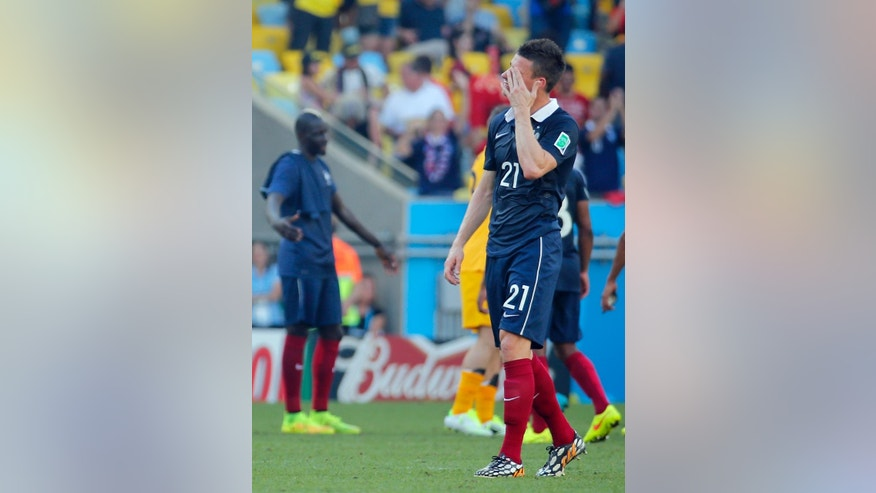 France's Laurent Koscielny reacts at the end of the World Cup quarterfinal soccer match between Germany and France at the Maracana Stadium in Rio de Janeiro, Brazil, Friday, July 4, 2014. (AP Photo/David Vincent)