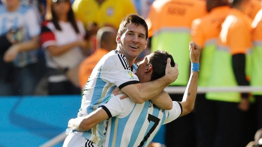 Argentina's Angel di Maria, right, and Lionel Messi celebrate after di Maria scored during the World Cup round of 16 soccer match between Argentina and Switzerland at the Itaquerao Stadium in Sao Paulo, Brazil, Tuesday, July 1, 2014. (AP Photo/Kirsty Wigglesworth)