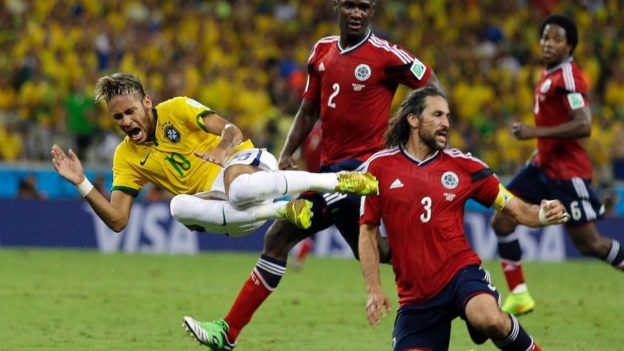 Brazil's Neymar is airborne after running in to Colombia's Mario Yepes during the World Cup quarterfinal soccer match between Brazil and Colombia at the Arena Castelao in Fortaleza, Brazil, Friday, July 4, 2014. (AP Photo/Natacha Pisarenko)
