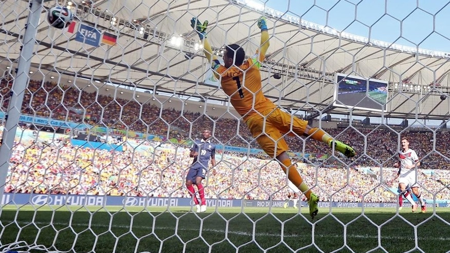 France's goalkeeper Hugo Lloris fails to stop a shot by Germany's Mats Hummels as he scored his side's first goal during the World Cup quarterfinal soccer match between Germany and France at the Maracana Stadium in Rio de Janeiro, Brazil, Friday, July 4, 2014. (AP Photo/Matthias Schrader)