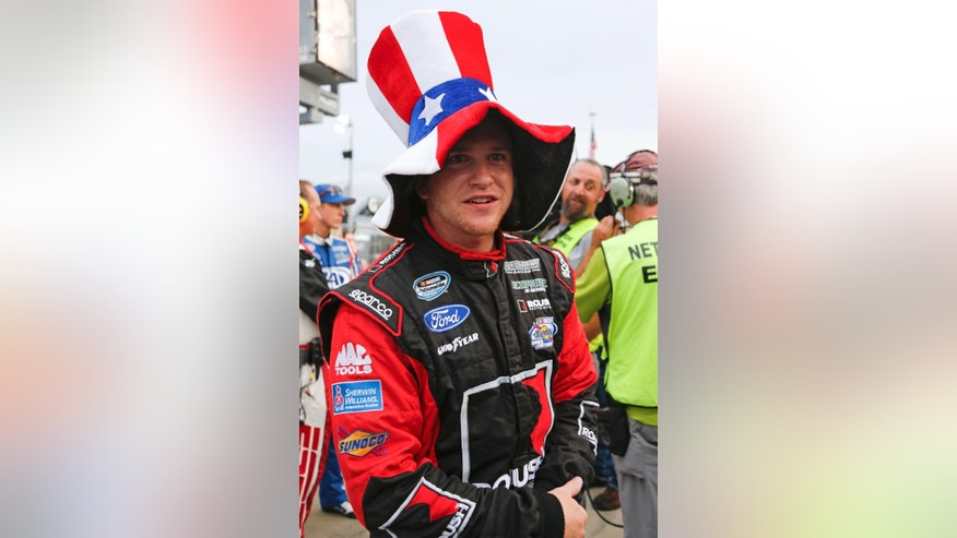 Chris Buescher wears a patriotic hat on pit road before the Nationwide series auto race at Daytona International Speedway in Daytona Beach, Fla., Friday, July 4, 2014. (AP Photo/Terry Renna)