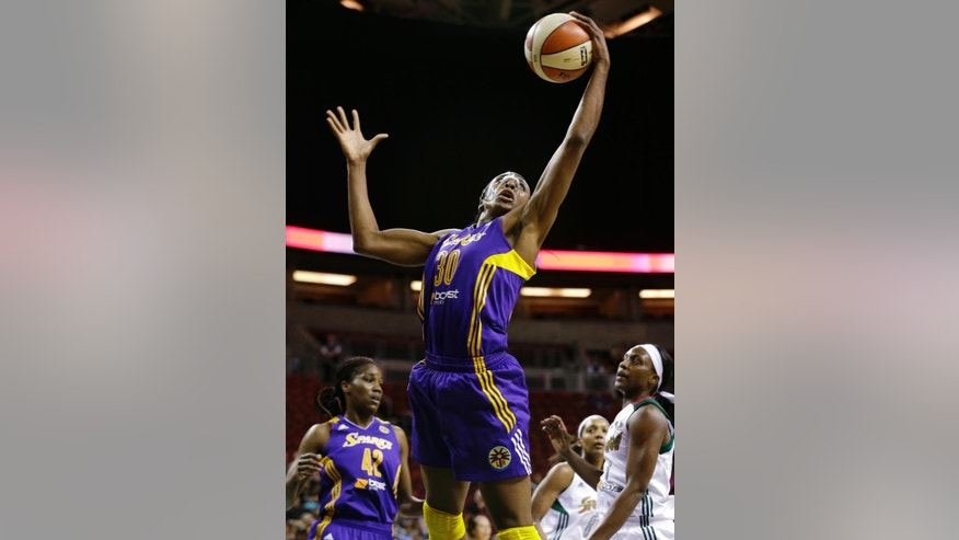 Los Angeles Sparks' Nneka Ogwumike grabs a rebound against the Seattle Storm in the first half of a WNBA basketball game Thursday, July 3, 2014, in Seattle. (AP Photo/Elaine Thompson)