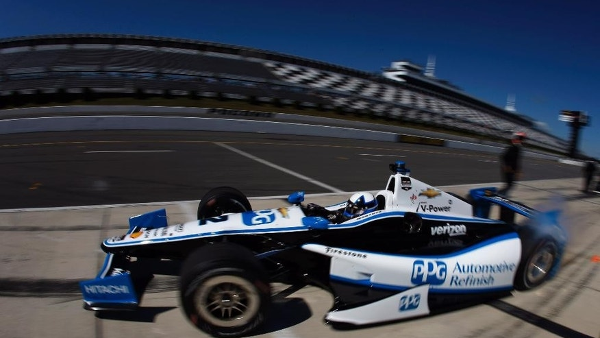 IndyCar driver Juan Pablo Montoya, of Colombia, pulls out of his pit during a practice session for Sunday's Pocono IndyCar 500 auto race, Saturday, July 5, 2014, in Long Pond, Pa. (AP Photo/Matt Slocum)