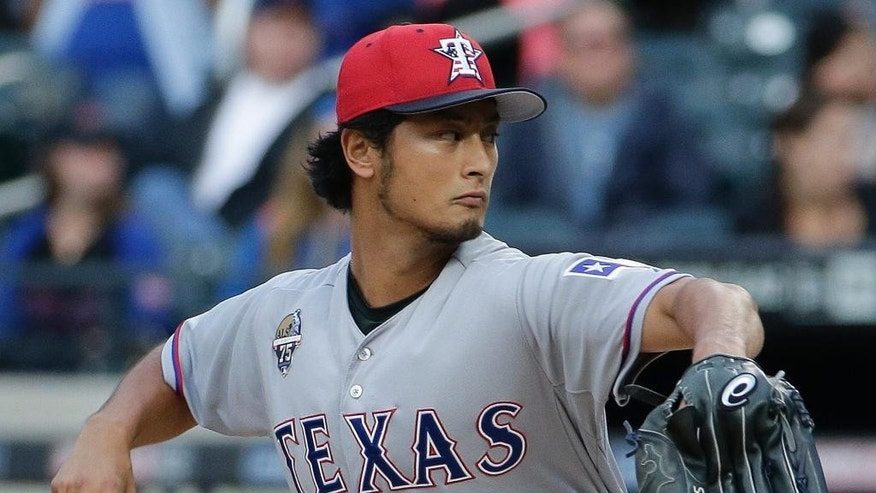 Texas Rangers pitcher Yu Darvish delivers against the New York Mets in the first inning of a baseball game on Friday, July 4, 2014, in New York. (AP Photo/Julie Jacobson)