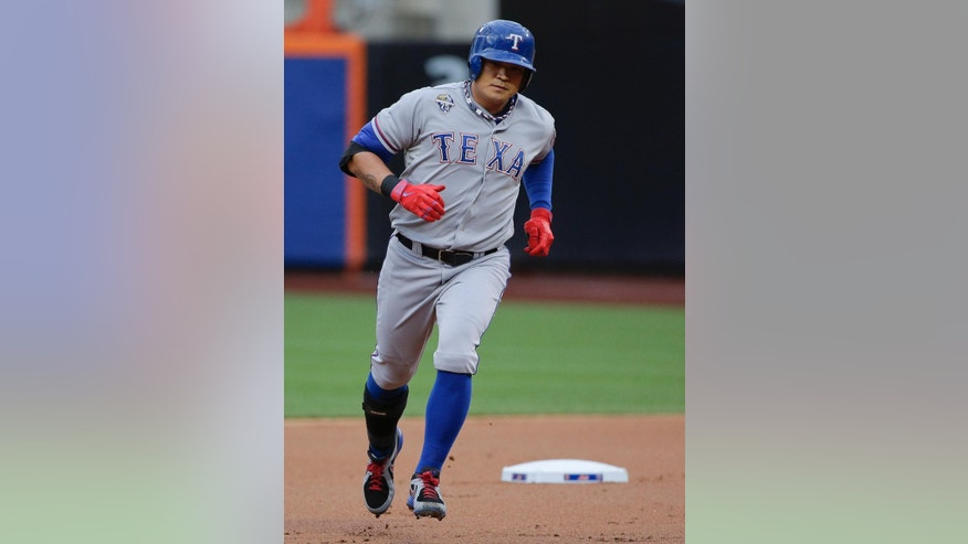 Texas Rangers' Shin-Soo Choo rounds the bases after hitting a solo home run against the New York Mets in the first inning of a baseball game on Friday, July 4, 2014, in New York. (AP Photo/Julie Jacobson)