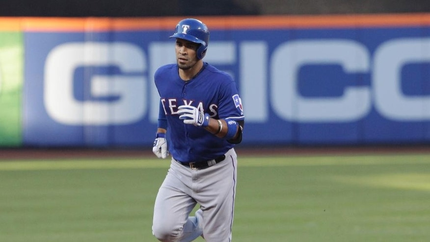 Texas Rangers' Robinson Chirinos rounds the bases after hitting a three-run home run off New York Mets pitcher Bartolo Colon in the first inning of a baseball game Saturday, July 5, 2014, in New York. (AP Photo/Mark Lennihan)