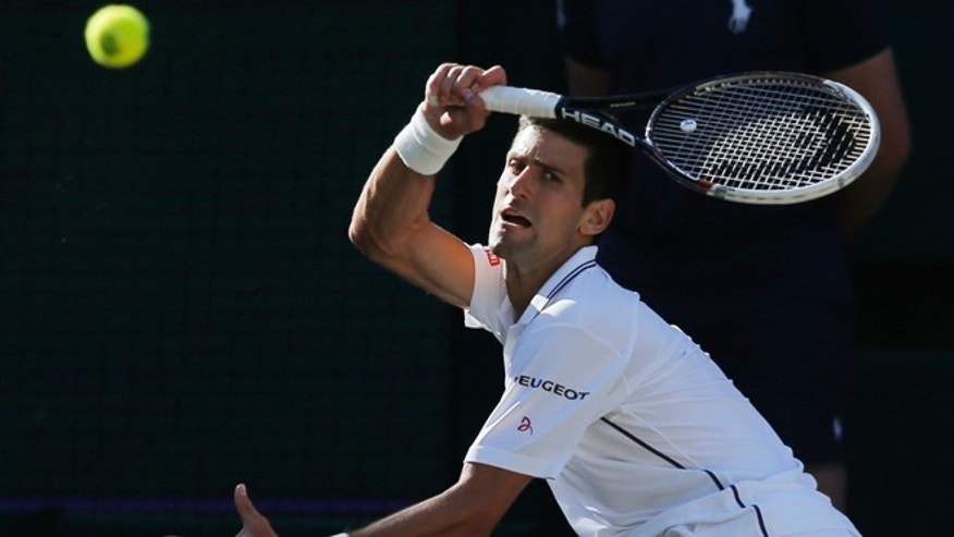 July 6, 2014: Novak Djokovic of Serbia plays a return to Roger Federer of Switzerland during their men's singles final match at the All England Lawn Tennis Championships in Wimbledon, London. (AP)
