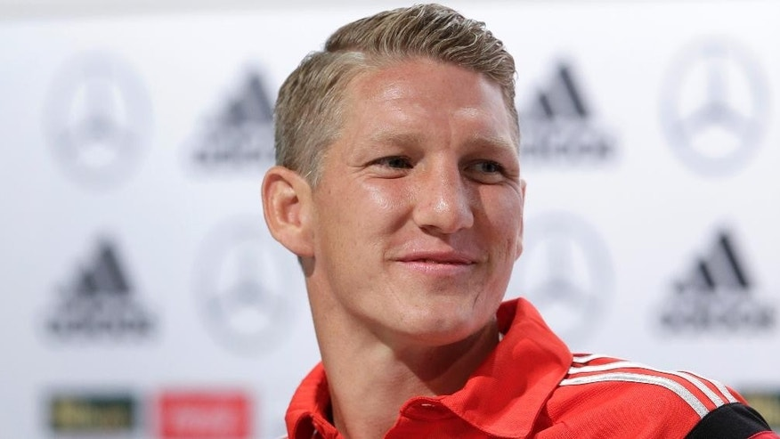 German national soccer player Bastian Schweinsteiger attends a news conference in Santo Andre near Porto Seguro, Brazil, Sunday, July 6, 2014. Germany faces Brazil on upcoming Tuesday in Mineirao Stadium in Belo Horizonte, in the semifinals of the World Cup. (AP Photo/Matthias Schrader)