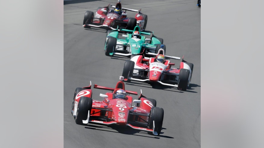 Scott Dixon (9), of Australia, leads Justin Wilson (19), of England, Charlie Kimball (83), and Sebastien Bourdais, of France (11), into turn one during the  Pocono IndyCar 500 auto race, Sunday, July 6, 2014, in Long Pond, Pa. (AP Photo/Mel Evans)