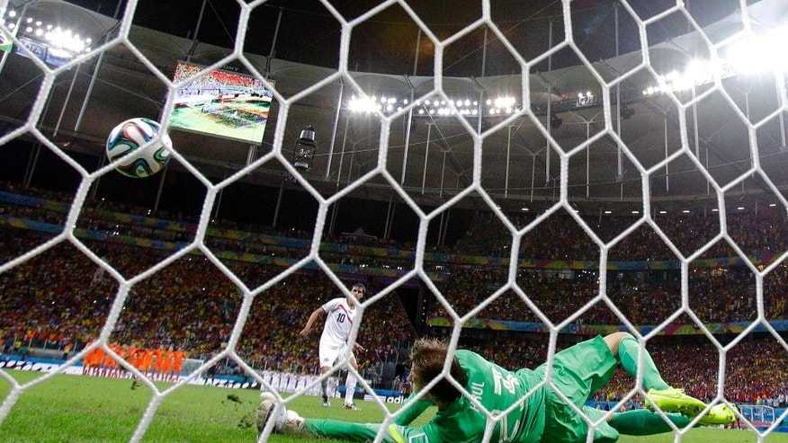 Netherlands' goalkeeper Tim Krul makes a save on Costa Rica's Bryan Ruiz during a penalty shootout in extra time during the World Cup quarterfinal soccer matchat the Arena Fonte Nova in Salvador, Brazil, Saturday, July 5, 2014. (AP Photo/Wong Maye-E)