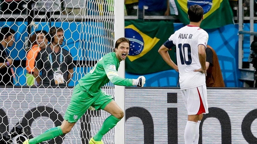 Netherlands' goalkeeper Tim Krul celebrates after saving a penalty from Costa Rica's Bryan Ruiz in a penalty shoot out during the World Cup quarterfinal soccer match between the Netherlands and Costa Rica at the Arena Fonte Nova in Salvador, Brazil, Saturday, July 5, 2014. (AP Photo/Matt Dunham)