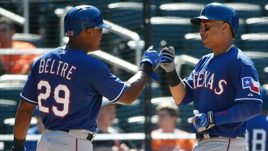 Texas Rangers Adrian Beltre, left, congratulates Leonys Martin, right, after scoring on Martin's eighth-inning, two-run, homer  during an interleague baseball game in New York, Sunday, July 6, 2014.  The Mets defeated the Rangers 8-4. (AP Photo/Kathy Willens)