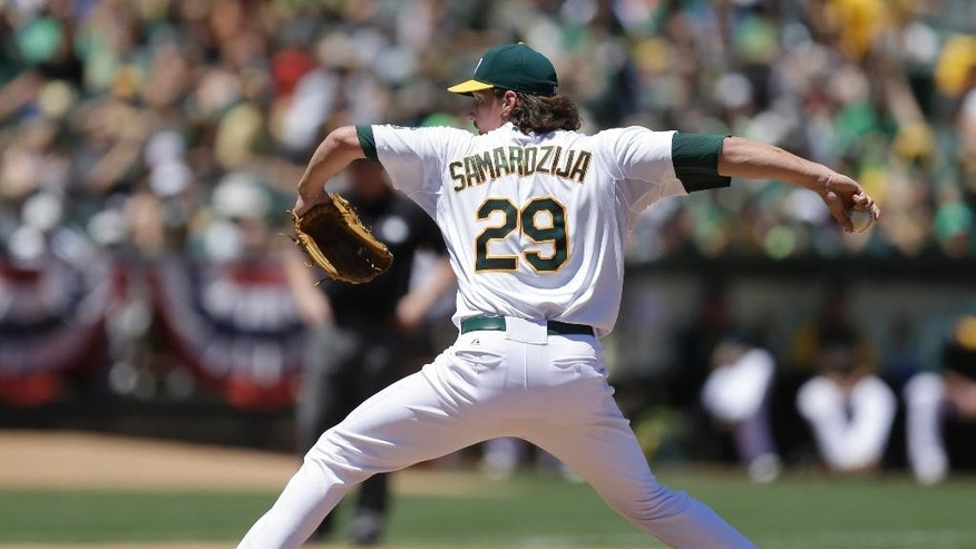 Oakland Athletics' Jeff Samardzija works against the Toronto Blue Jays in the fourth inning of a baseball game Sunday, July 6, 2014, in Oakland, Calif. (AP Photo/Ben Margot)