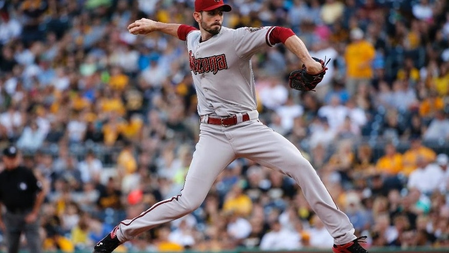 Arizona Diamondbacks starting pitcher Brandon McCarthy delivers during the first inning of a baseball game against the Pittsburgh Pirates in Pittsburgh, Thursday, July 3, 2014. (AP Photo/Gene J. Puskar)