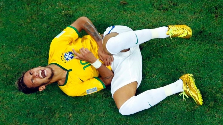 Brazil's Neymar grimaces in pain during the World Cup quarterfinal soccer match between Brazil and Colombia at the Arena Castelao in Fortaleza, Brazil, Friday, July 4, 2014. (AP Photo/Fabrizio Bensch, pool)