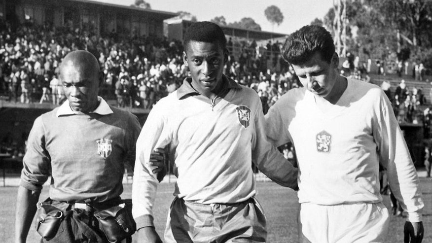 CORRECTS YEAR OF CHILE WORLD CUP TO 1962 - FILE - This February 1962 file photo, shows Edson Arantes do Nascimento known as Pele, center, trainer Mario Americo, left, and Czech player Masopust. After Neymar's injury in this 2014 Soccer World Cup while playing against Colombia, Brazil remembers when Pele, its best player in the Chile 1962 World Cup was also sidelined because of injury in the tournament, and Brazil still won the title. (AP Photo/File)