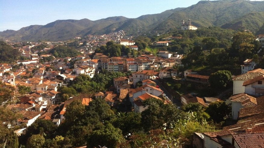 "This June, 25, 2014, photo, shows a birds eye view of the town of Ouro Preto Brazil. Removed from the bustling World Cup host city of Belo Horizonte, Ouro Preto is the charming colonial town that gave birth to Brazil's independence. A UNESCO world heritage site whose name means ""Black Gold,"" is a former mining village whose tremendous wealth made it a cultural focal point of the era. (AP Photo/Frank Griffiths)"