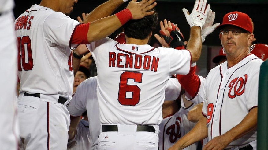 Washington Nationals' Anthony Rendon (6) celebrates his two-run homer during the sixth inning of an interleague baseball game against the Baltimore Orioles at Nationals Park, Monday, July 7, 2014, in Washington. (AP Photo/Alex Brandon)