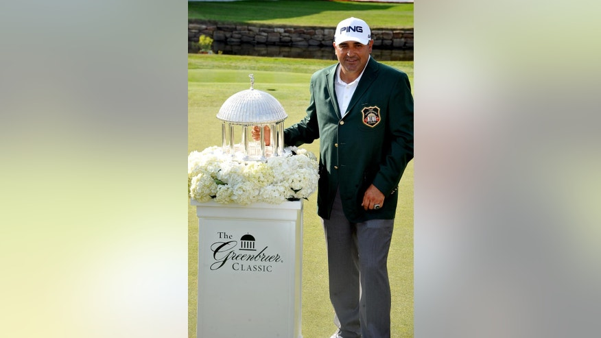 Angel Cabrera with The Greenbrier Classic Springhouse Trophy after winning the Greenbrier Classic golf tournament at the Greenbrier Resort in White Sulphur Springs, W.Va., Sunday, July 6, 2014  (AP Photo/Chris Tilley)