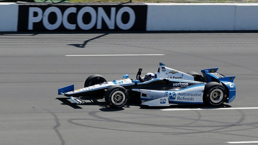 Juan Pablo Montoya (2), of Colombia, pumps his fist as he wins the Pocono IndyCar 500 auto race on Sunday, July 6, 2014, in Long Pond, Pa. (AP Photo/Mel Evans)