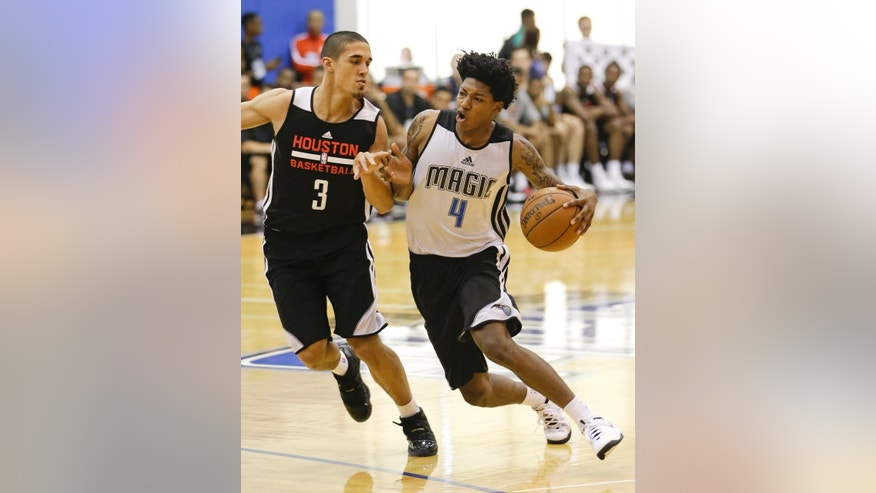 Orlando Magic's Elfrid Payton (4) drives around Houston Rockets' Nick Johnson (3) during an NBA summer league basketball game in Orlando, Fla., Monday, July 7, 2014. (AP Photo/John Raoux)